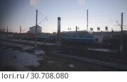 Купить «View from the window of a moving train», видеоролик № 30708080, снято 21 марта 2019 г. (c) Андрей Радченко / Фотобанк Лори