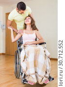 couple with female in wheelchair near door. Стоковое фото, фотограф Яков Филимонов / Фотобанк Лори