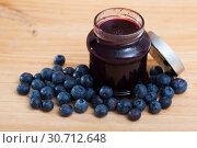 Купить «Sweet blueberry jam in jar and berries on wooden surface», фото № 30712648, снято 15 октября 2019 г. (c) Яков Филимонов / Фотобанк Лори