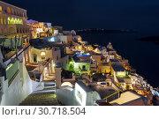 Купить «View of the city of Fira at night, Santorini, Greece», фото № 30718504, снято 7 июня 2017 г. (c) Наталья Волкова / Фотобанк Лори