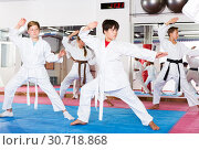 Купить «Kids in kimonos practicing effective karate techniques», фото № 30718868, снято 16 июня 2019 г. (c) Яков Филимонов / Фотобанк Лори