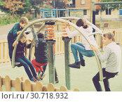 Купить «Children playing on swing», фото № 30718932, снято 16 июля 2019 г. (c) Яков Филимонов / Фотобанк Лори