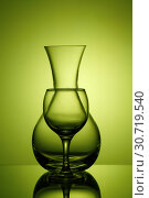 Купить «Pitcher and wine glass on green background», фото № 30719540, снято 23 апреля 2019 г. (c) Okssi / Фотобанк Лори
