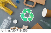 Купить «green recycle symbol with household waste on grey», видеоролик № 30719556, снято 8 мая 2019 г. (c) Syda Productions / Фотобанк Лори