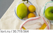 Купить «reusable shopping bags for food with fruits», видеоролик № 30719564, снято 5 мая 2019 г. (c) Syda Productions / Фотобанк Лори