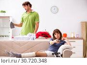 Купить «Husband helping leg injured wife in housework», фото № 30720348, снято 4 октября 2018 г. (c) Elnur / Фотобанк Лори