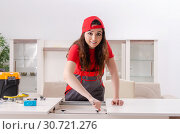 Купить «Female contractor repairing furniture at home», фото № 30721276, снято 6 декабря 2018 г. (c) Elnur / Фотобанк Лори