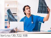 Купить «Young male doctor radiologist working at the clinic», фото № 30722108, снято 5 ноября 2018 г. (c) Elnur / Фотобанк Лори