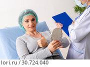 Купить «Woman preparing for cosmetic plastic surgery», фото № 30724040, снято 14 ноября 2018 г. (c) Elnur / Фотобанк Лори