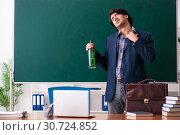 Купить «Male teacher drinking in the classroom», фото № 30724852, снято 21 декабря 2018 г. (c) Elnur / Фотобанк Лори