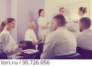 Купить «Group of adult students in break between lessons», фото № 30726056, снято 5 октября 2017 г. (c) Яков Филимонов / Фотобанк Лори
