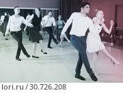 Купить «Couples enjoying active boogie-woogie», фото № 30726208, снято 24 мая 2017 г. (c) Яков Филимонов / Фотобанк Лори