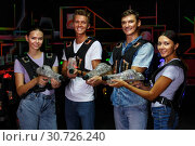 Купить «Group portrait of young people with laser guns having fun together», фото № 30726240, снято 23 августа 2018 г. (c) Яков Филимонов / Фотобанк Лори