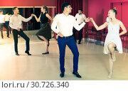 Laughing group people dancing lindy hop in pairs. Стоковое фото, фотограф Яков Филимонов / Фотобанк Лори