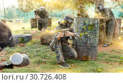 Купить «Team of adult people playing paintball on battlefield outdoor, r», фото № 30726408, снято 22 сентября 2018 г. (c) Яков Филимонов / Фотобанк Лори