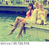 Купить «Women resting on harbour seaside», фото № 30726516, снято 4 апреля 2020 г. (c) Яков Филимонов / Фотобанк Лори