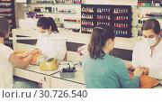 Купить «women getting their nails done at beauty salon», фото № 30726540, снято 28 апреля 2017 г. (c) Яков Филимонов / Фотобанк Лори