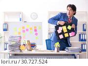 Купить «Young male handsome employee in conflicting priorities concept», фото № 30727524, снято 7 января 2019 г. (c) Elnur / Фотобанк Лори