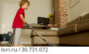 Купить «Funny baby child play with vacuum cleaner, active child», видеоролик № 30731072, снято 10 мая 2019 г. (c) Ekaterina Demidova / Фотобанк Лори