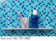 Bathroom. Shelf with glass, toothbrush, and mouthwash. Стоковое фото, фотограф Сергей Молодиков / Фотобанк Лори