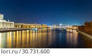 Купить «Moskva River and Krymsky or Crimean Bridge (at night)-- is a steel suspension bridge in Moscow, Russia. The bridge spans the Moskva River 1800 metres south-west from the Kremlin», фото № 30731600, снято 13 октября 2018 г. (c) Владимир Журавлев / Фотобанк Лори
