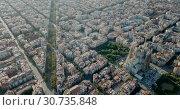 Купить «Aerial view of cityscape of Barcelona, Eixample district and Sagrada Familia», видеоролик № 30735848, снято 16 ноября 2018 г. (c) Яков Филимонов / Фотобанк Лори