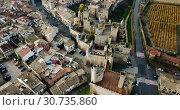 Купить «Aerial view of impressive medieval Royal Palace of Olite in autumn day, Navarre, Spain», видеоролик № 30735860, снято 20 декабря 2018 г. (c) Яков Филимонов / Фотобанк Лори