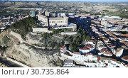 Купить «Aerial view of impressive medieval castle of Order of Calatrava on hill in town of Alcaniz, Spain», видеоролик № 30735864, снято 26 декабря 2018 г. (c) Яков Филимонов / Фотобанк Лори