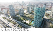 Купить «Aerial view of new residential complex of Diagonal Mar i el Front Maritim del Poblenou in sunny day, Barcelona, Spain», видеоролик № 30735872, снято 5 марта 2019 г. (c) Яков Филимонов / Фотобанк Лори