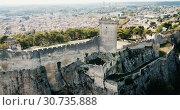 Купить «Aerial view of ruined medieval castle of Chateau de Beaucaire on background of French commune of Beaucaire», видеоролик № 30735888, снято 24 октября 2018 г. (c) Яков Филимонов / Фотобанк Лори