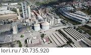 Купить «Aerial view of cement production plant», видеоролик № 30735920, снято 29 июля 2018 г. (c) Яков Филимонов / Фотобанк Лори