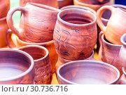 Купить «Pottery mugs closeup. Exhibition sale.», фото № 30736716, снято 10 августа 2018 г. (c) Акиньшин Владимир / Фотобанк Лори