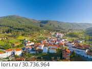 Купить «Aerial view of small town with red roofs during sunrise time. Top View of Valhelhas village in central Portugal», фото № 30736964, снято 27 апреля 2019 г. (c) Кирилл Трифонов / Фотобанк Лори