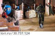 Купить «Paintball players in battlefield», фото № 30737124, снято 10 июля 2017 г. (c) Яков Филимонов / Фотобанк Лори