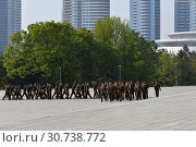 Купить «Pyongyang, North Korea. Pyongyang. The soldiers», фото № 30738772, снято 1 мая 2019 г. (c) Знаменский Олег / Фотобанк Лори
