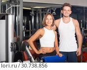 Купить «healthy young man and woman taking pause between exercising in gym», фото № 30738856, снято 4 октября 2016 г. (c) Яков Филимонов / Фотобанк Лори