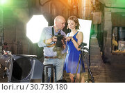 Купить «Photographer showing photos on camera to model girl», фото № 30739180, снято 5 октября 2018 г. (c) Яков Филимонов / Фотобанк Лори