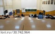 Купить «Ufa, Russia - April 20, 2017: Students at Bashkir State University. Large audience», видеоролик № 30742964, снято 20 апреля 2017 г. (c) Mikhail Erguine / Фотобанк Лори
