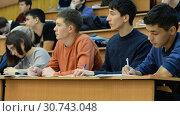 Купить «Ufa, Russia - April 20, 2017: Students at Bashkir State University. Large audience», видеоролик № 30743048, снято 20 апреля 2017 г. (c) Mikhail Erguine / Фотобанк Лори