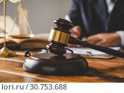 Купить «Law theme, mallet of the judge, law enforcement officers, evidence-based cases, and documents taken into account.», фото № 30753688, снято 20 августа 2018 г. (c) easy Fotostock / Фотобанк Лори