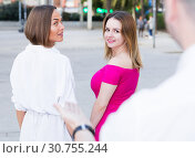 Купить «Young women are walking and stranger man is want acquaintance with them», фото № 30755244, снято 18 октября 2017 г. (c) Яков Филимонов / Фотобанк Лори