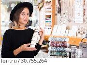 Купить «woman in hat choosing stylish bracelets», фото № 30755264, снято 16 октября 2017 г. (c) Яков Филимонов / Фотобанк Лори