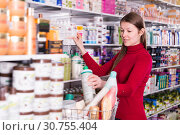 Купить «Adult woman is choosing bath and body products», фото № 30755404, снято 22 марта 2018 г. (c) Яков Филимонов / Фотобанк Лори
