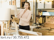 Купить «Female purchaser buying torchere», фото № 30755472, снято 15 ноября 2017 г. (c) Яков Филимонов / Фотобанк Лори