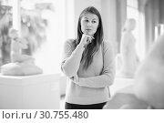 Купить «Portrait of young woman standing near exposition in art museum», фото № 30755480, снято 18 ноября 2017 г. (c) Яков Филимонов / Фотобанк Лори
