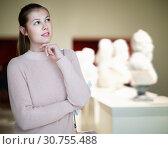 Купить «Portrait of young woman standing near exposition in art museum», фото № 30755488, снято 18 ноября 2017 г. (c) Яков Филимонов / Фотобанк Лори