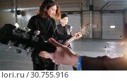 Купить «An excited rock group having a repetition», видеоролик № 30755916, снято 6 июля 2020 г. (c) Константин Шишкин / Фотобанк Лори