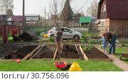 Купить «Family in the garden, timelapse», видеоролик № 30756096, снято 11 мая 2019 г. (c) Игорь Жоров / Фотобанк Лори