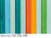 Купить «Beautiful horizontal texture of colorful red green blue orange yellow gray metal fence», фото № 30756180, снято 25 мая 2020 г. (c) Татьяна Куклина / Фотобанк Лори