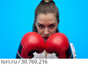 Купить «Ready for a fight. Determined business woman wearing boxing gloves.», фото № 30760216, снято 12 марта 2019 г. (c) Pavel Biryukov / Фотобанк Лори